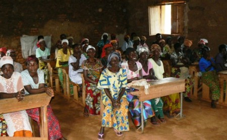 Meeting with Large Group of Beneficiaries in Classroom